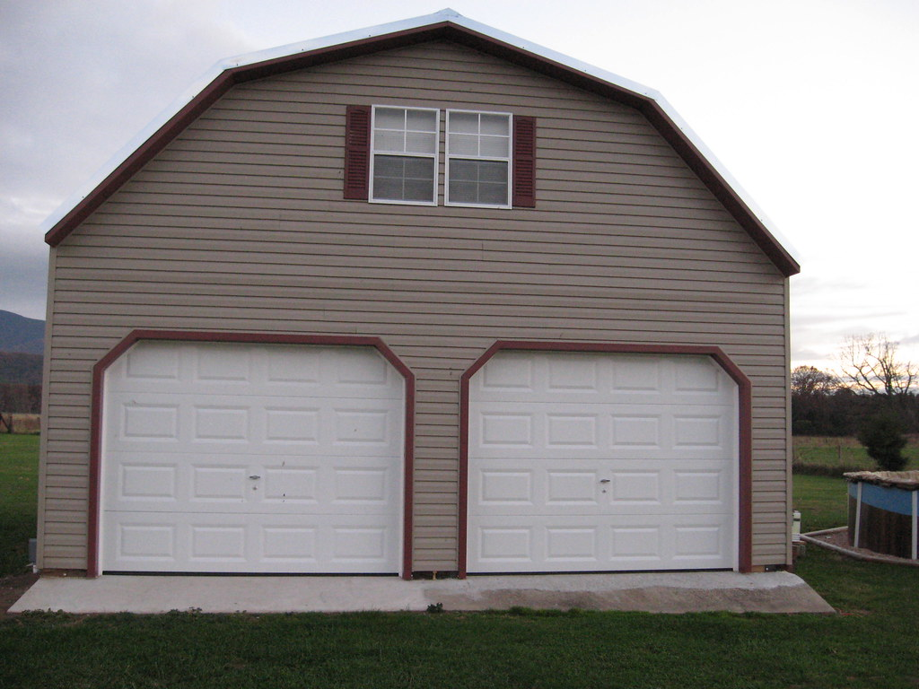 2 story buildings two story garages vinyl garage flickr for Prefab double garage