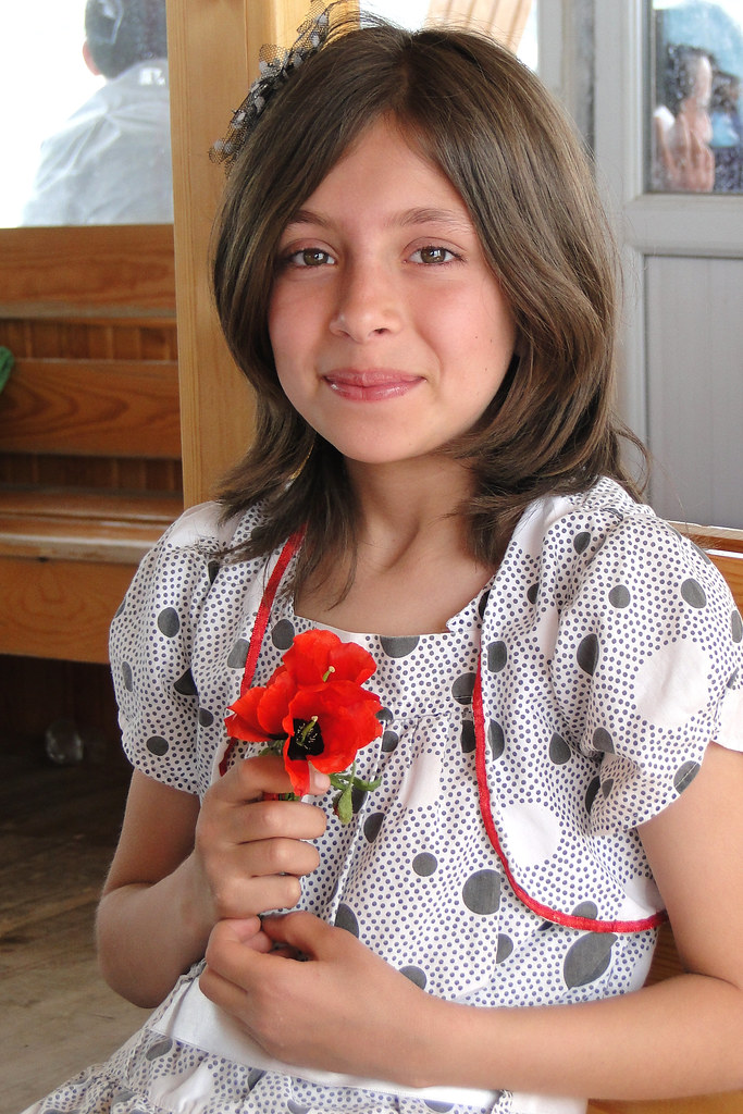 Young Turkish Girl With Flower - Aboard Ferry From Akdamar -9284