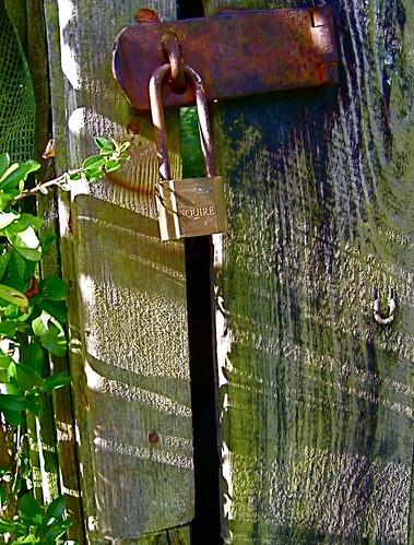 padlock and shadows | by Norman Taylor