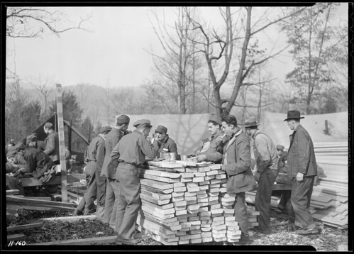 This 'Counter Restaurant' Is at CCC Camp, TVA #22, near Esco, Tennessee. Temporarily the Boys Are Eating Outdoors and Using for a Lunch Counter Lumber Which Is to Be Used in the Construction of Their Winter Barracks | by The U.S. National Archives
