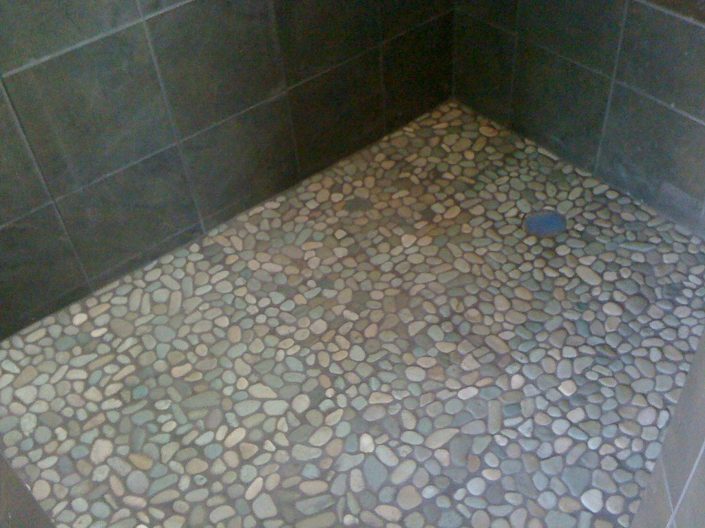 Pebble tile shower floor unique shower floor we installed flickr pebble tile shower floor by hibbs homes dailygadgetfo Choice Image