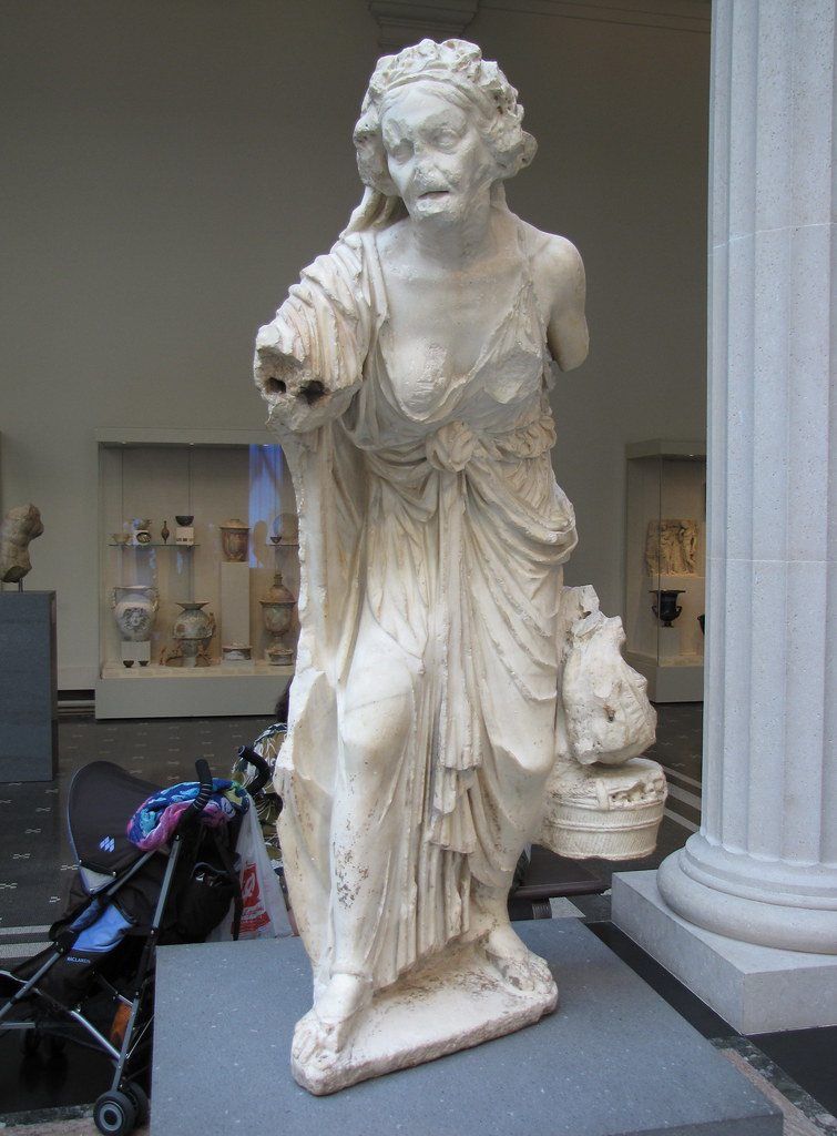 Marble Statue Of An Old Market Woman Marble Statue Of An