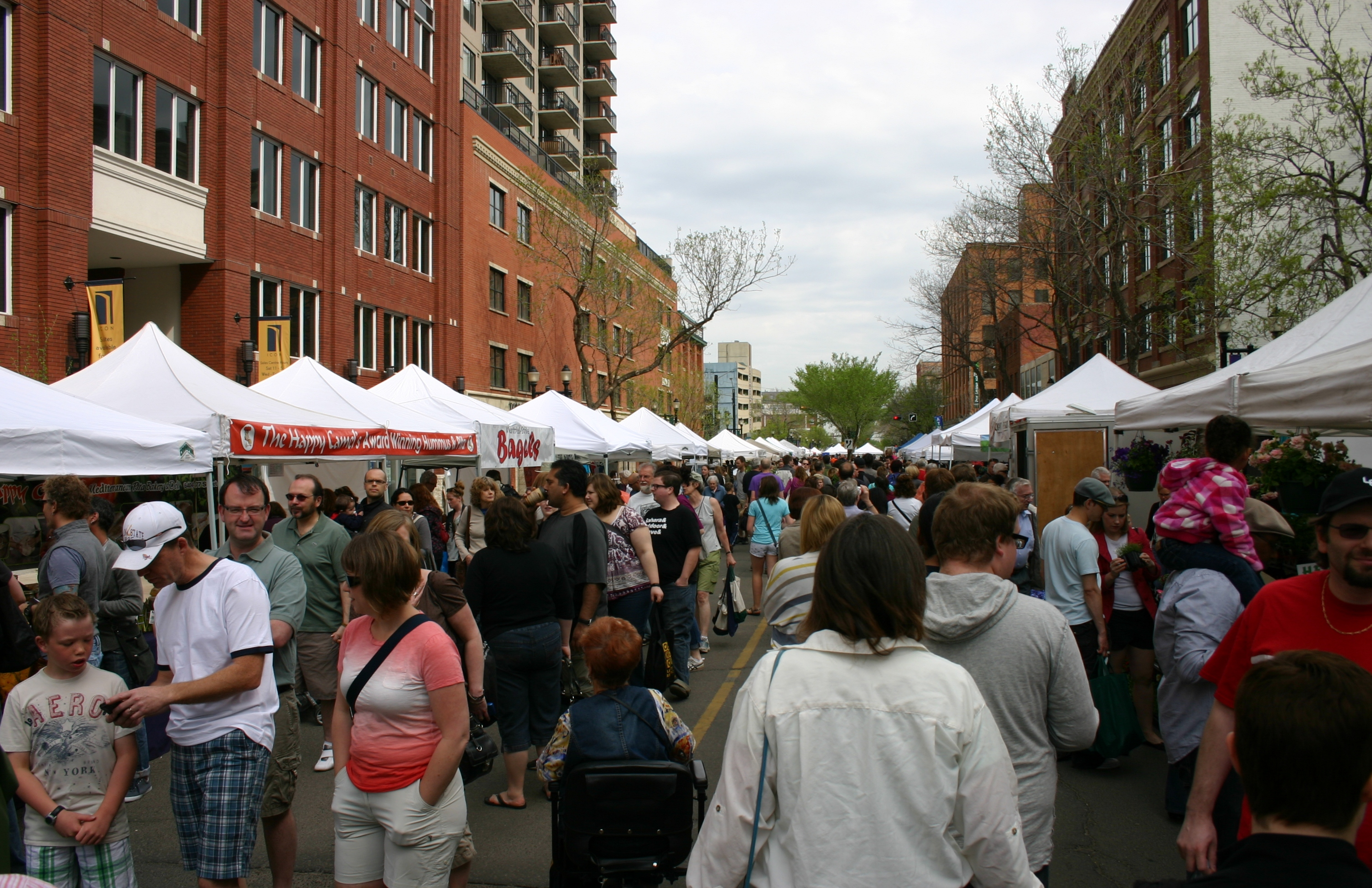 The street teems with people when the market is open on Saturdays from May to October.