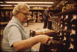 Librarian at the Card Files at Senior High School in New Ulm Minnesota ..., 10/1974 | by The U.S. National Archives