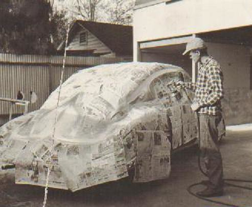 Old school car paint dad working on the fill paint for Car painting school
