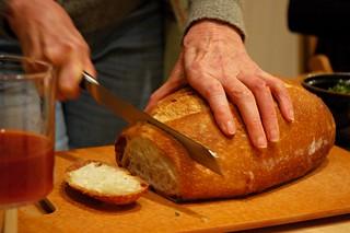 Breaking bread, juice, dinner party, Broadview townhouse, Seattle, Washington, USA