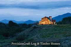 Exterior View at Twilight | Custom Handcrafted Log Home | PrecisionCraft Log Homes | by PrecisionCraft Log & Timber Homes