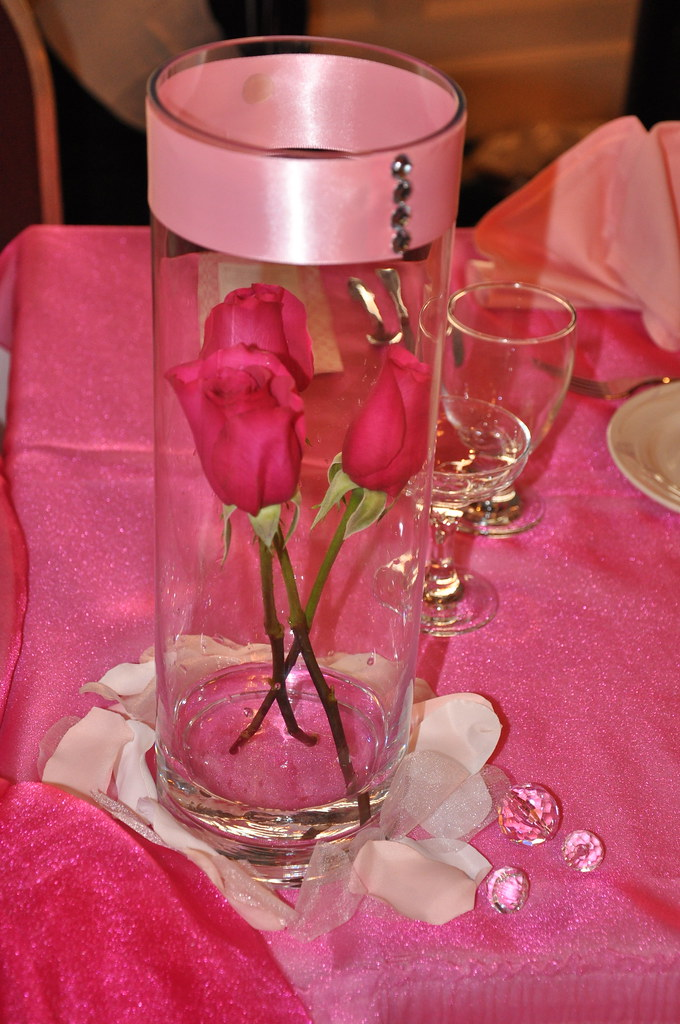 Quinceanera centerpiece clear vase wrapped with a pink