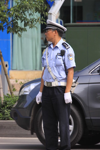 Chinese police officer in Chengdu | by Erwyn van der Meer