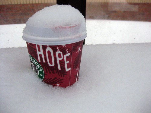 Abandoned Lipstick-Stained Starbucks Cup in Bus Stop Bench Snowdrift | by brownpau