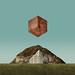 Wooden Cube Over Landscape