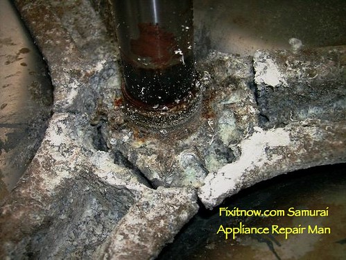 Closeup Of Corroded Drum Spider On A Frigidaire Front Load