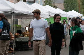 Chris, Alexi, and Abby walking among the vendors | by Mills Baker