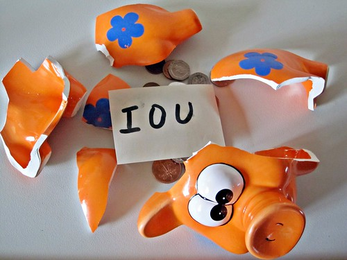 IOU in a piggy bank | by Images_of_Money