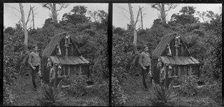 Edgar Williams standing beside a small hut, Pounawea, Catlins River, January 1906 | by National Library NZ on The Commons