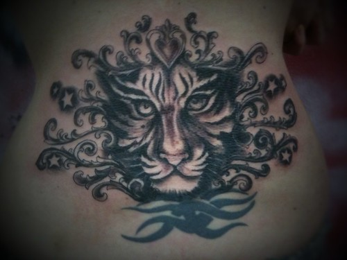 another cover up with the tiger by dejavu tattoo studio 30