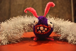 Web of Woe: Deadly Knitshade's Mothra gives a grin | by Deadly Knitshade