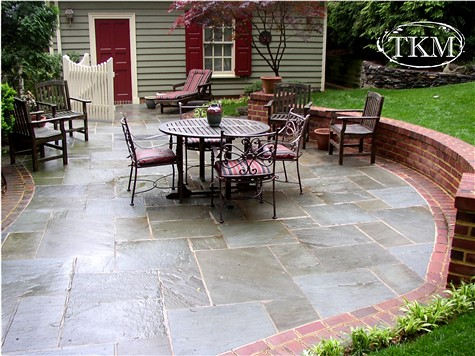 Mortared Flagstone Patio With Brick Borders And Seat Wall - brick wall patio designs small home