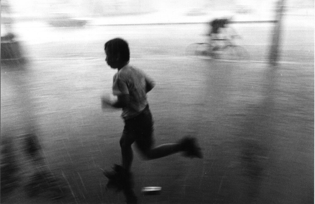 boy running in the rain romania 1997 ruairi o 39 brien flickr. Black Bedroom Furniture Sets. Home Design Ideas