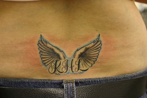 Butterfly tattoos with initials in wings