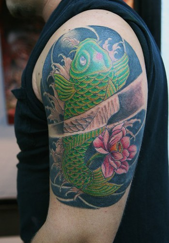 Koi fish green with fllower black background tattoo of a for Green koi fish