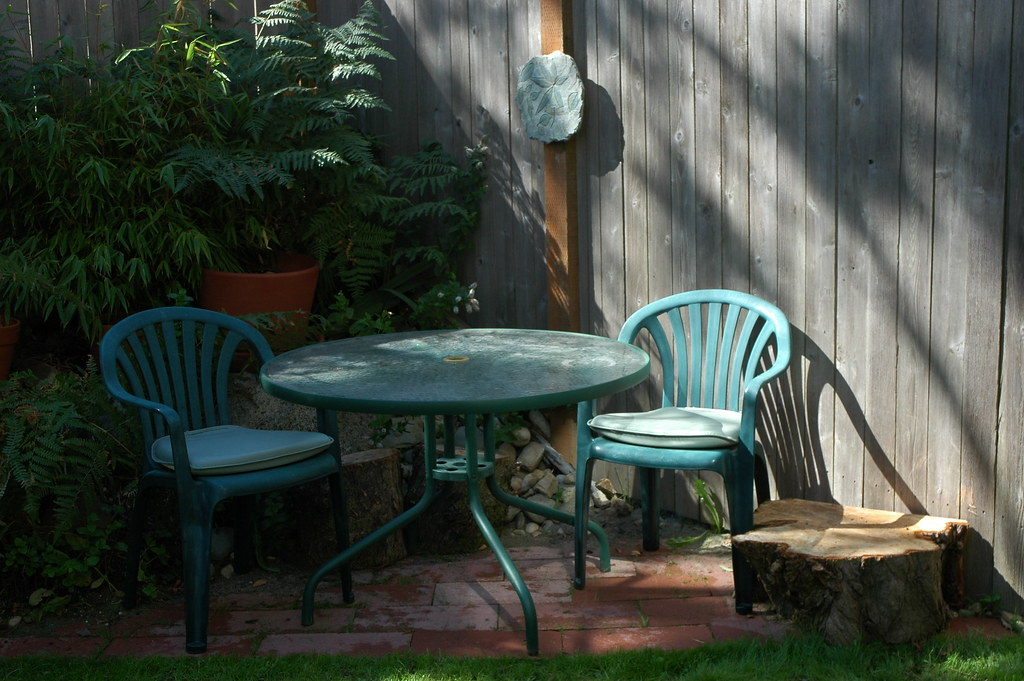 ... Rockery Small Patio In The Backyard Of A Northend Townhouse, With  Table, Chairs, Rockery