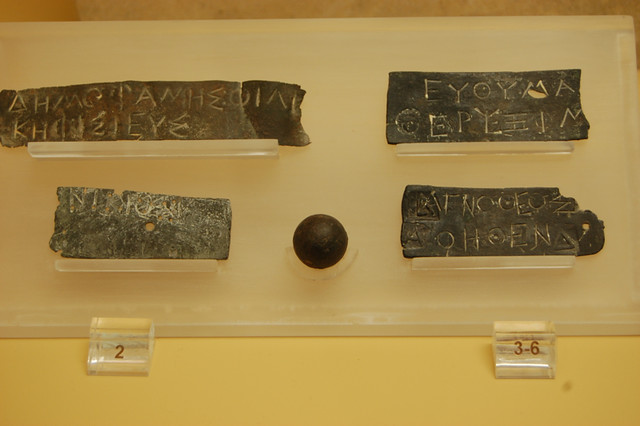 pinakia - bronze allotment plates for jury duty. Agora Museum, Athens.