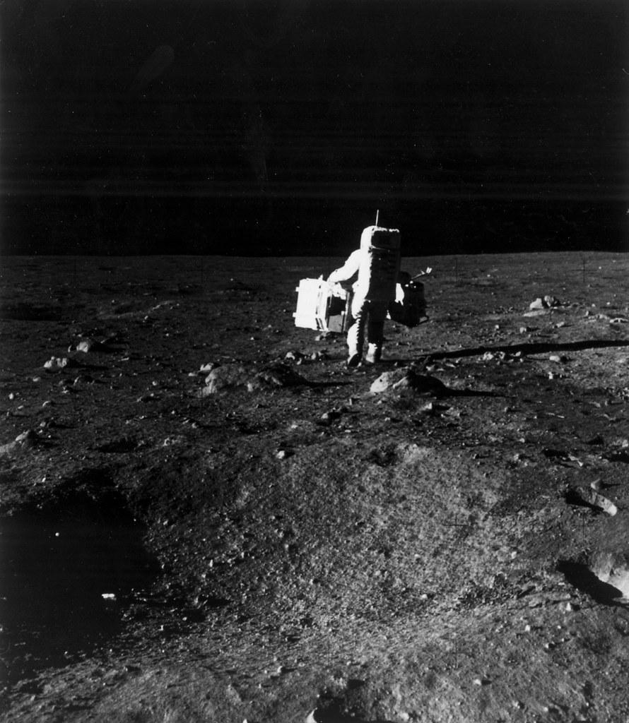 apollo 11 astronaut aldrin carries equipment on lunar surf