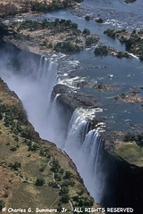 Mist rises from the chasm at Vic Falls | by WildImages