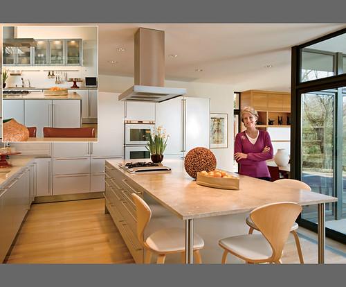 Warm modern kitchen white cabinets limestone counters for Warm kitchen flooring