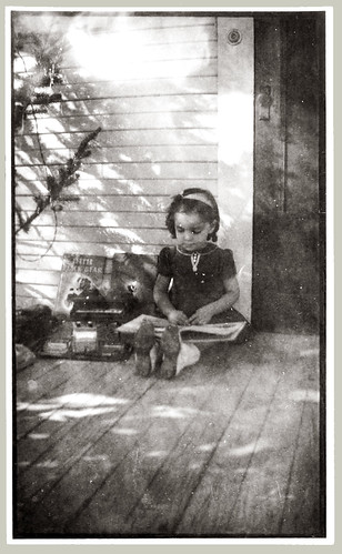 Child readin on porch