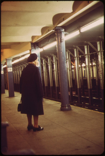 A Woman Waits for A Train at the 79th Street Station. 05/1973 | by The U.S. National Archives