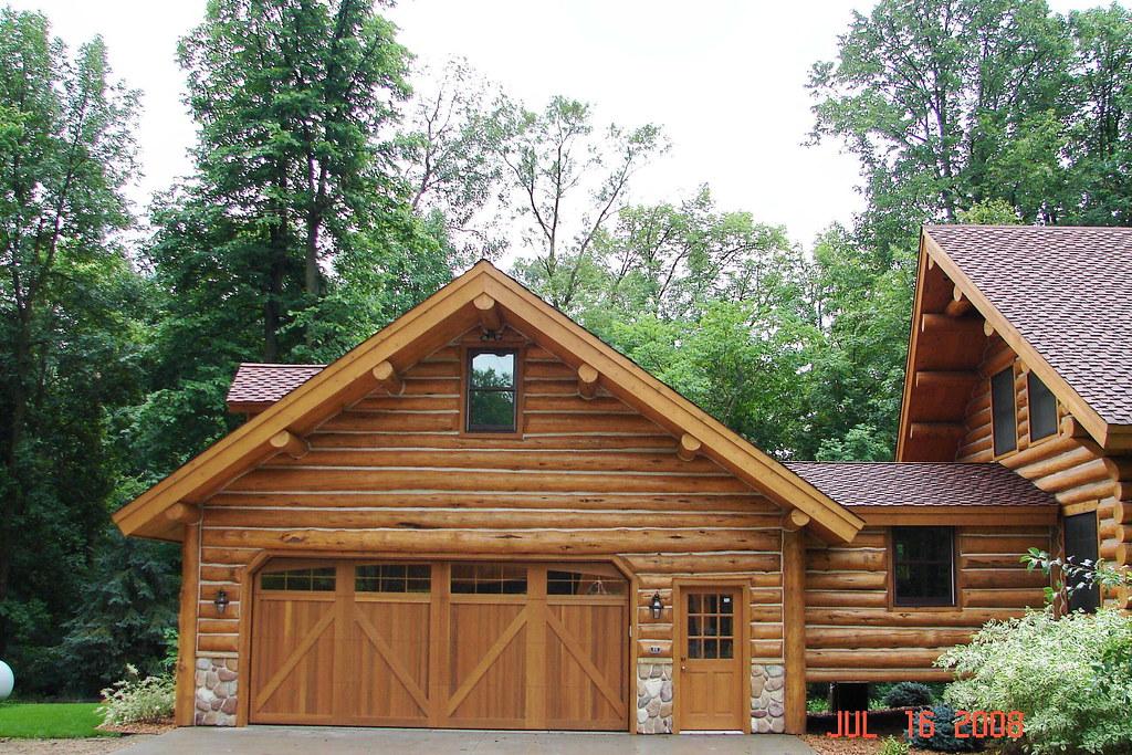 Log garage this log garage matches the existing home for Log cabin garage