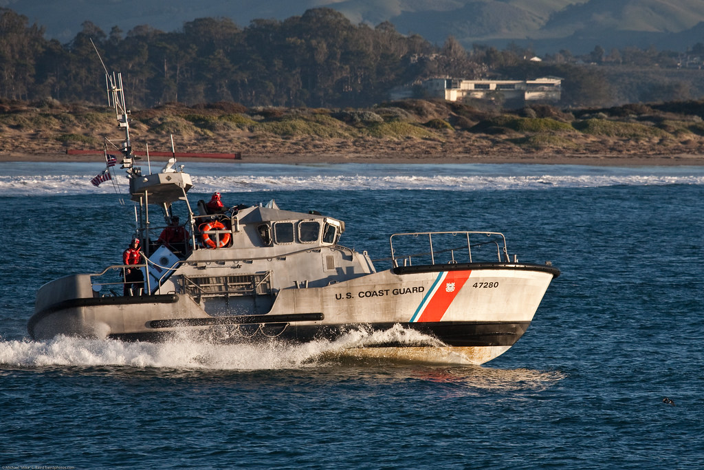 Coast guard 47 39 motor lifeboat escorts fishing boats 08dec for Fishing boat motor