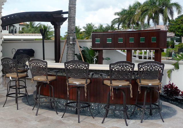Patio bar and grill with custom storage this custom for Balcony restaurant and bar