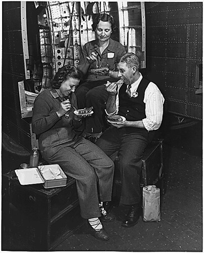 American workers give up holiday to speed Victory. The Blackwelder family celebrated Thanksgiving at their benches in a Glenn Martin Company plant: ca. 11/1942 | by The U.S. National Archives