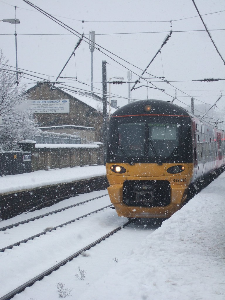 class 333 train in the snow at guiseley railway station. Black Bedroom Furniture Sets. Home Design Ideas