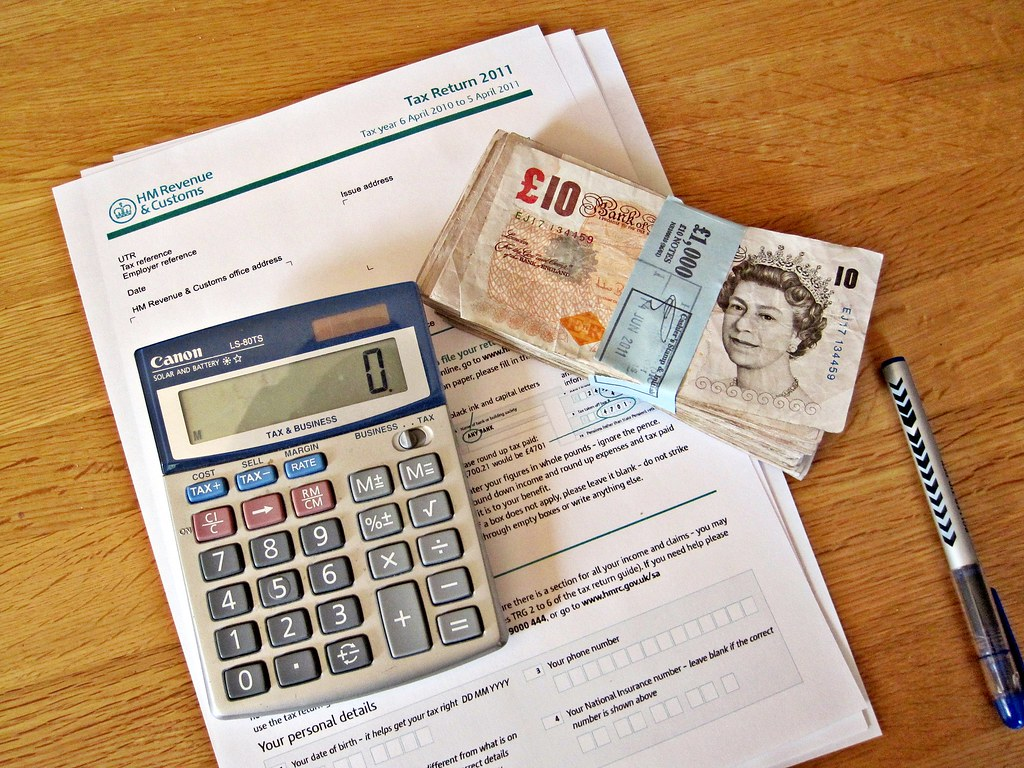 How Much Is Tax >> Income Tax Return   A calculator, wad of cash, pen and a ...