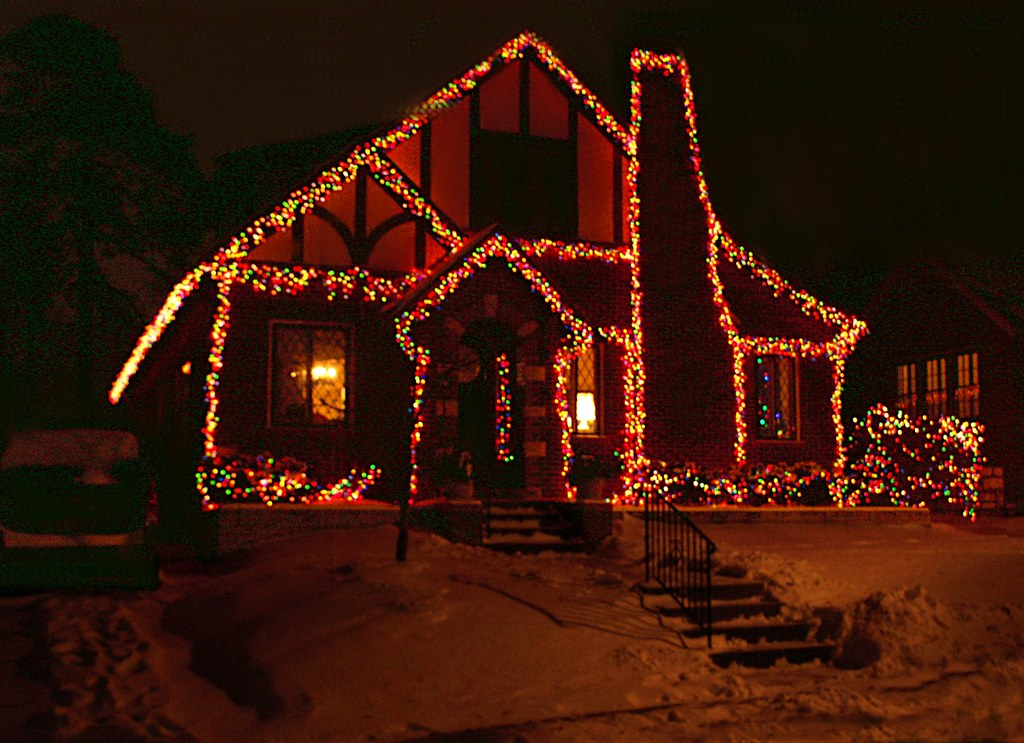tudor house with multicolored christmas lights walking a flickr