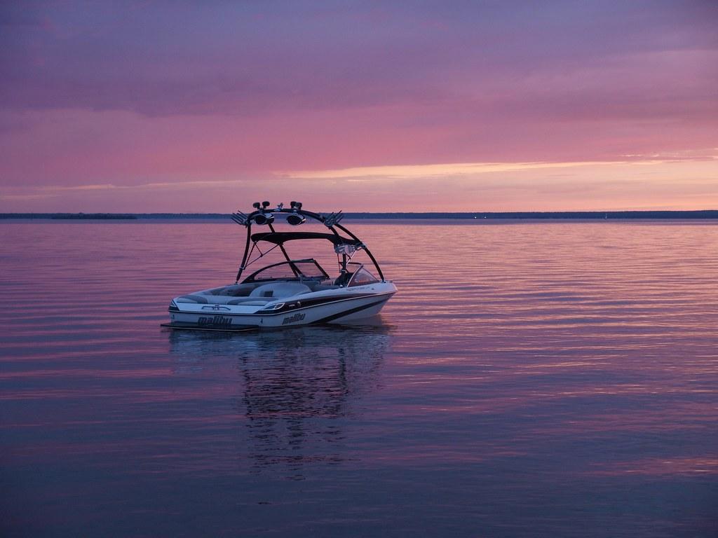 sun setting on skippen family malibu boat