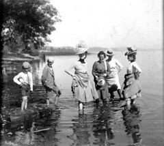 Women and children wading in lake | by UW Digital Collections