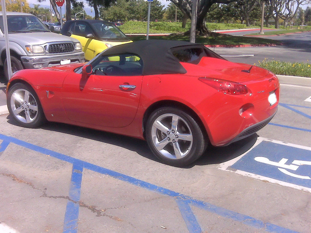 pontiac solstice a small little red sports car in a handic flickr. Black Bedroom Furniture Sets. Home Design Ideas
