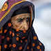 Old veiled woman in Ibra, Oman