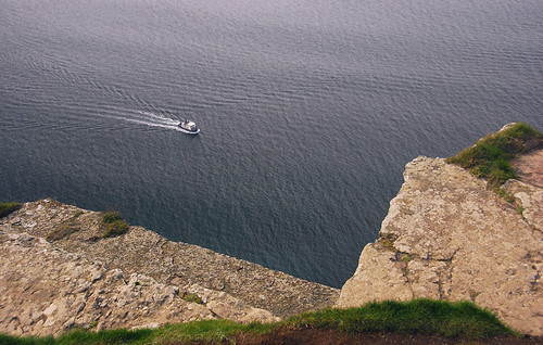 The ferry from above on the Cliffs of Moher on the west coast of Ireland