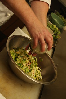 Brussel Sprouts Salad: Seasoning salad with salt and pepper for taste | by Indiana Public Media