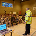 An officer promotes Road safety to soldiers