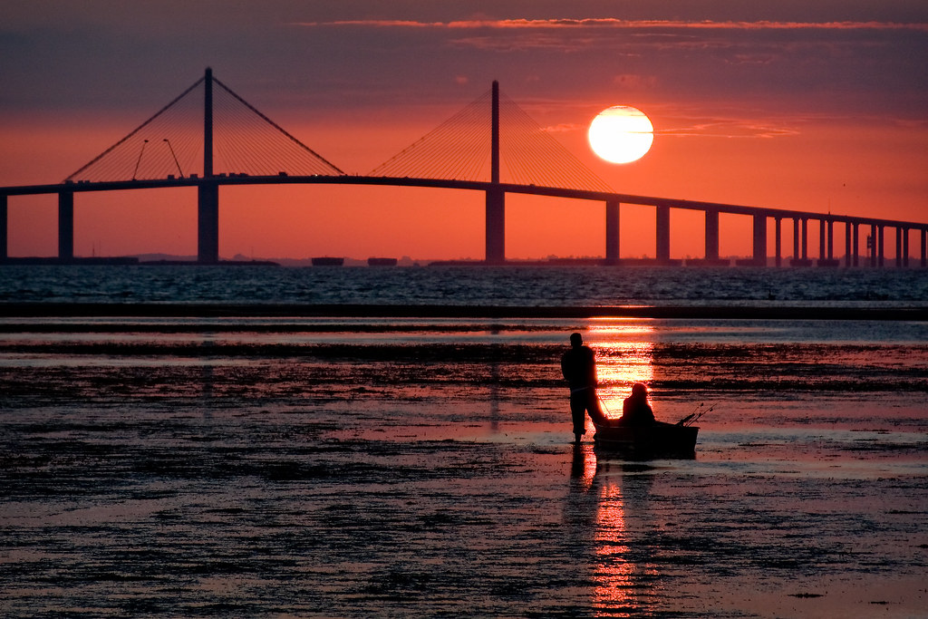 Father and son going fishing near the sunshine skyway brid for Skyway bridge fishing