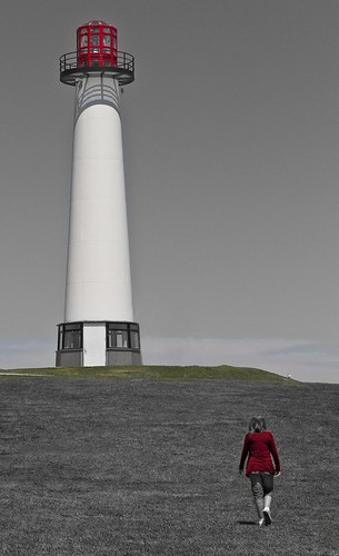 Girl in red jacket walking to the lighthouse | by Roland Bogush