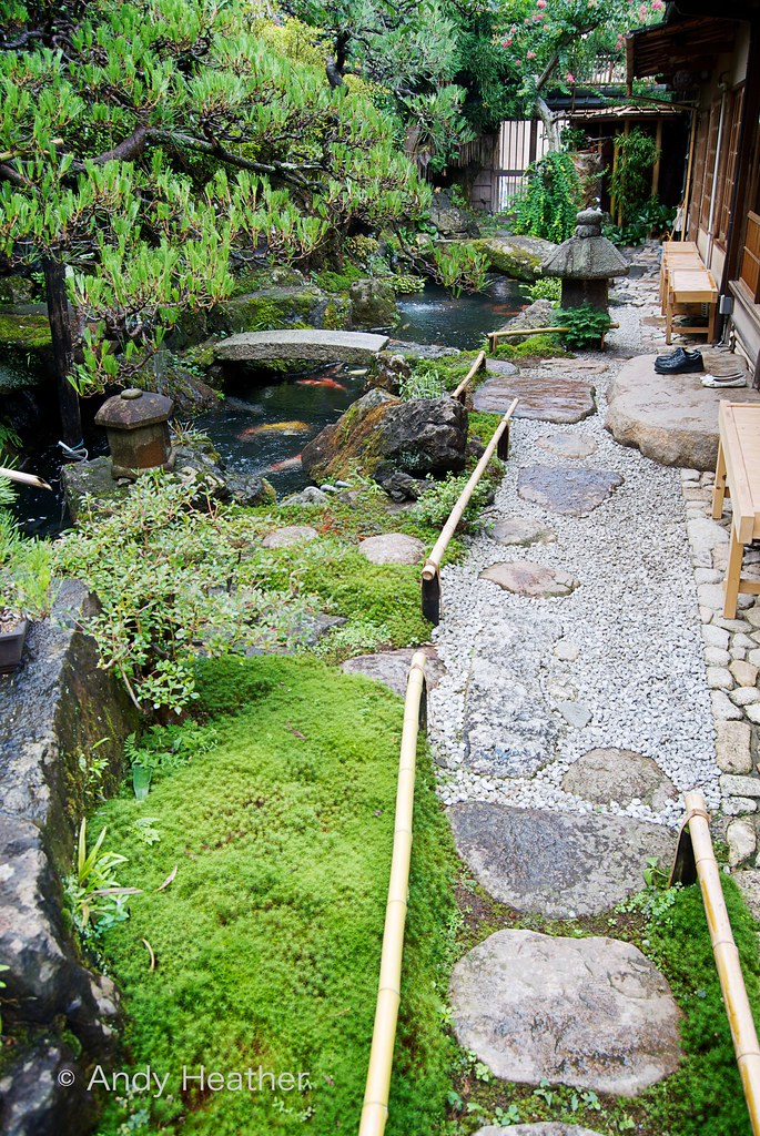 Kyoto Japanese Garden With Koi Carp Pond And A Pair Of Sho