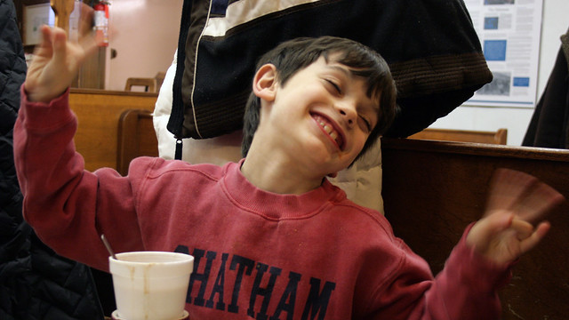 a boy shows his approval over hot cocoa